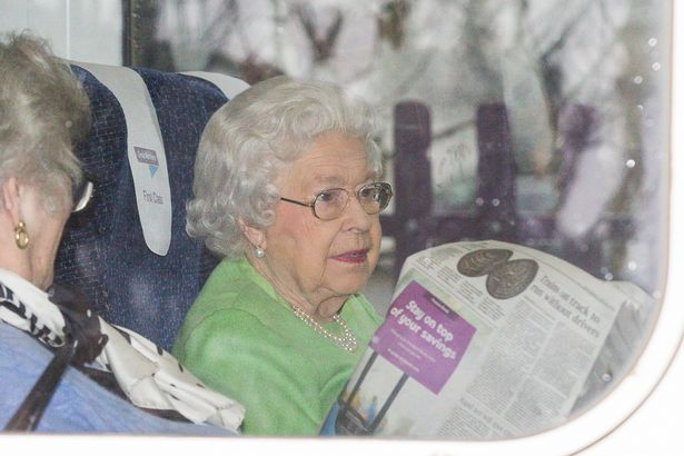 Queen returns to London by train