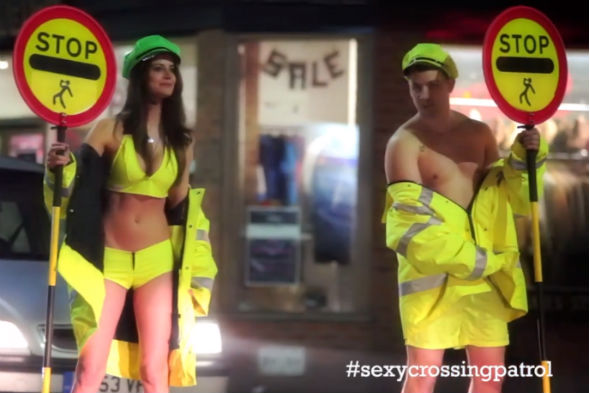 Scantily-clad lollipop man and woman staff pedestrian crossing