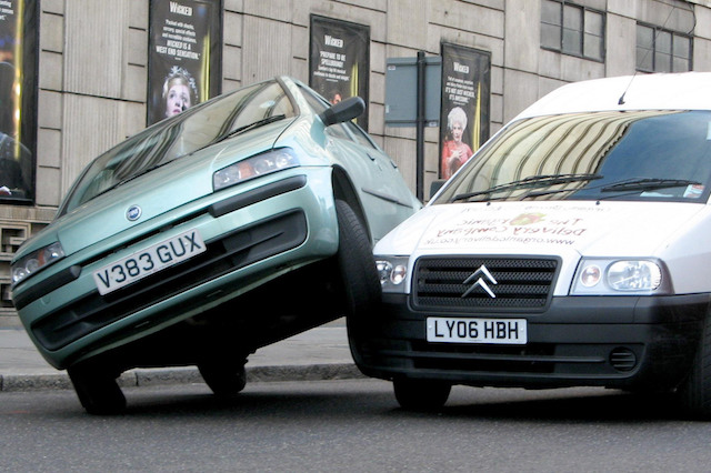 A car rests on top of a van, after a coming together in Victoria, London.