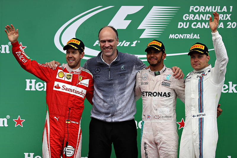 Lewis Hamilton of Great Britain and Mercedes GP celebrates on the podium with Sebastian Vettel of Germany and Ferrari and Valtteri Bottas of Finland and Williams during the Canadian Formula One Grand Prix at Circuit Gilles Villeneuve on June 12, 2016 in Montreal, Canada.