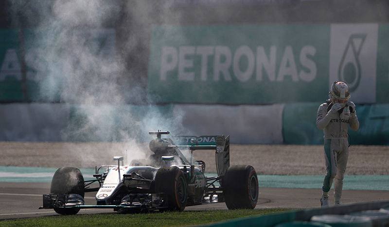 Mercedes driver Lewis Hamilton of Britain walks from his car after an engine failure during the Malaysian Formula One Grand Prix at the Sepang International Circuit in Sepang, Malaysia, Sunday, Oct. 2, 2016