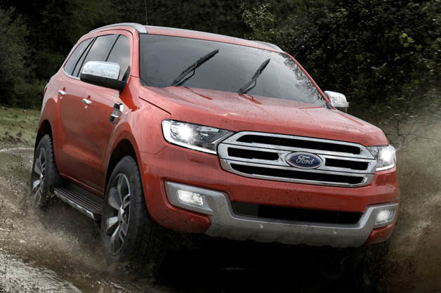 Ford Everest SUV splashing through the mud
