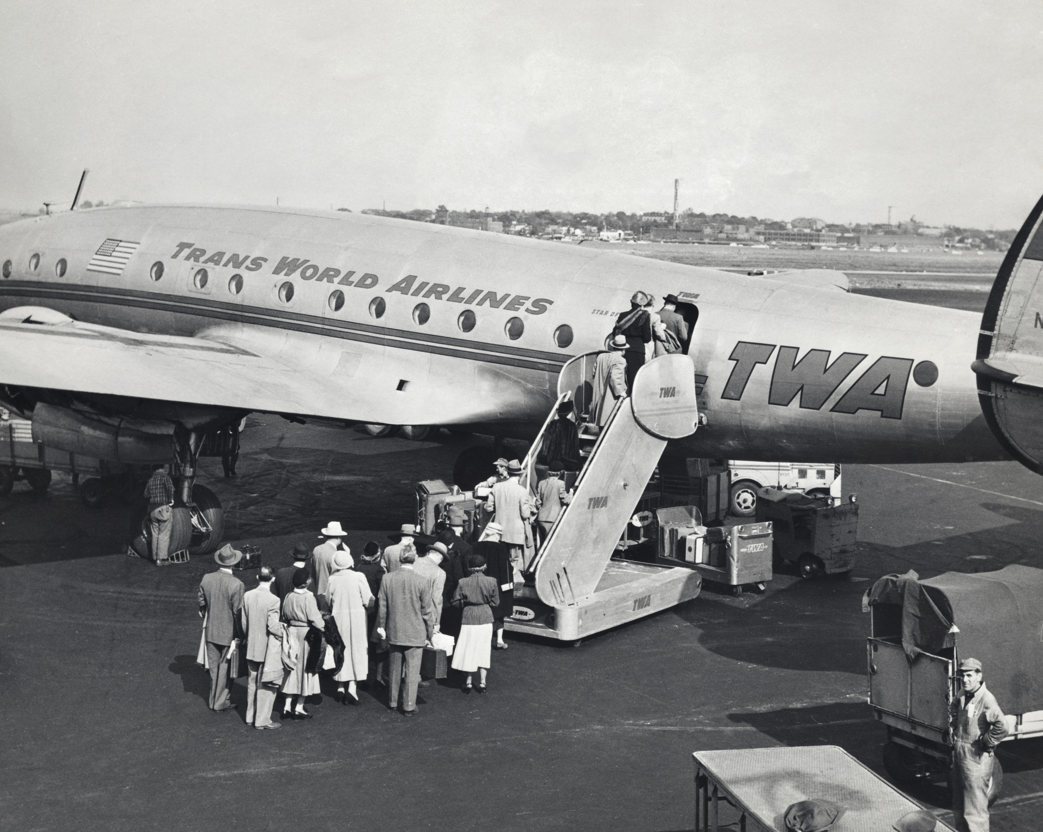 High angle view of passengers boarding an airplane