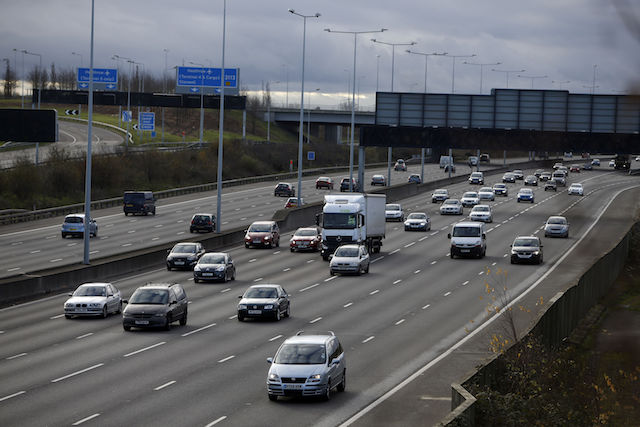 File photo dated 24/12/14 of cars drive on the M25 motorway, as the Society of Motor Manufacturers and Traders have said that black is back as the UK's most popular new car colour.