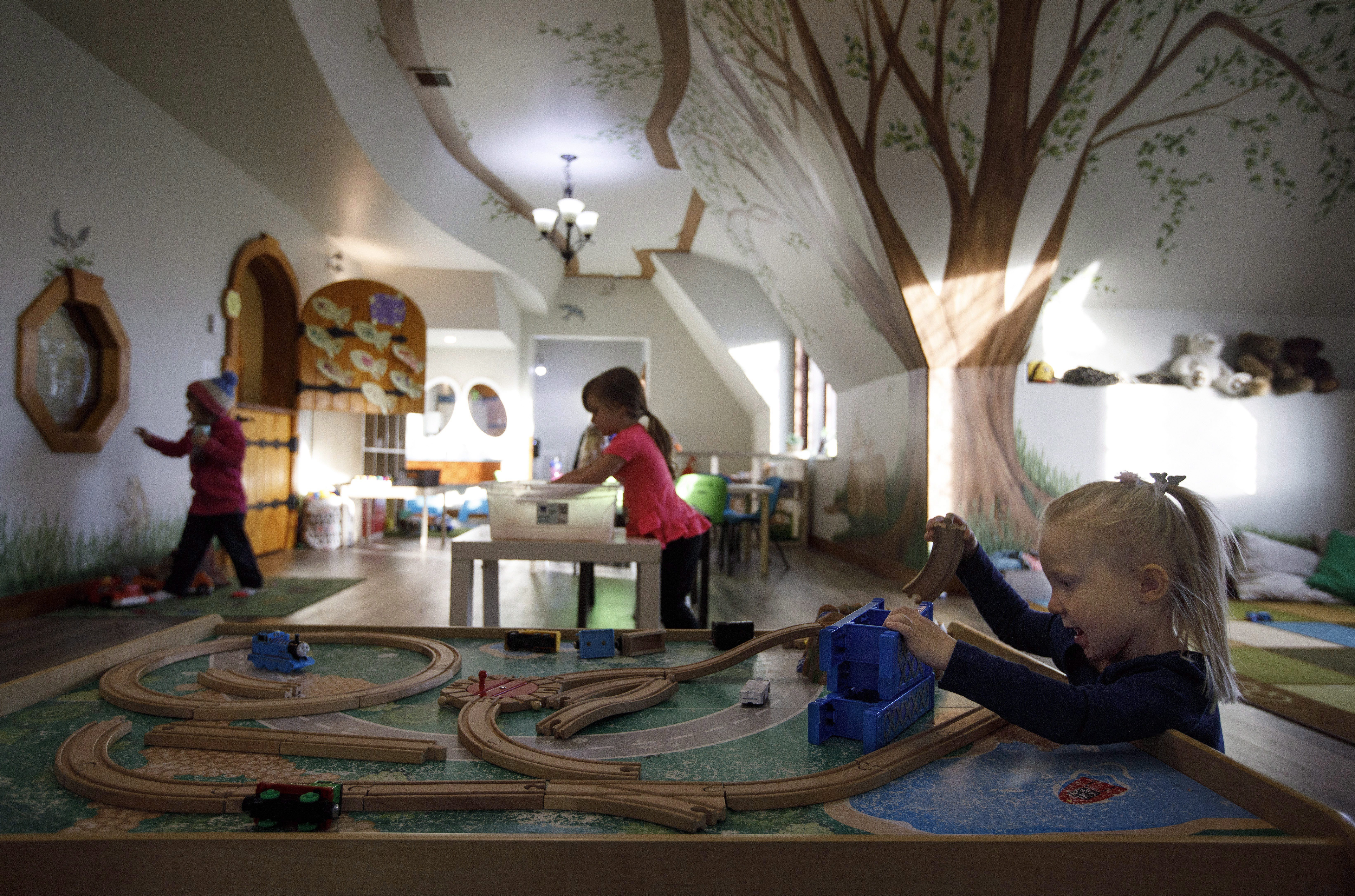 Kids play at Fable Child Care Centre in Morinville, Alta., on Oct. 24,