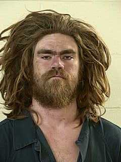 Police: Drunk, Naked Man Kicked Window out of Police Car