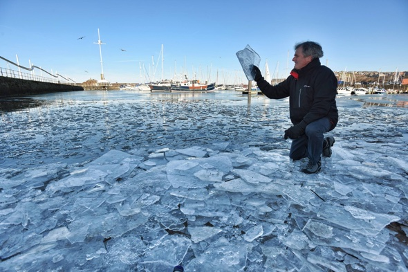Sea freezes over at Whitehaven Harbour in Cumbria