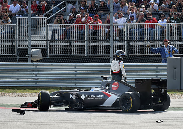 Adrian Sutil walks away from his stricken Sauber at the 2014 US Grand Prix.