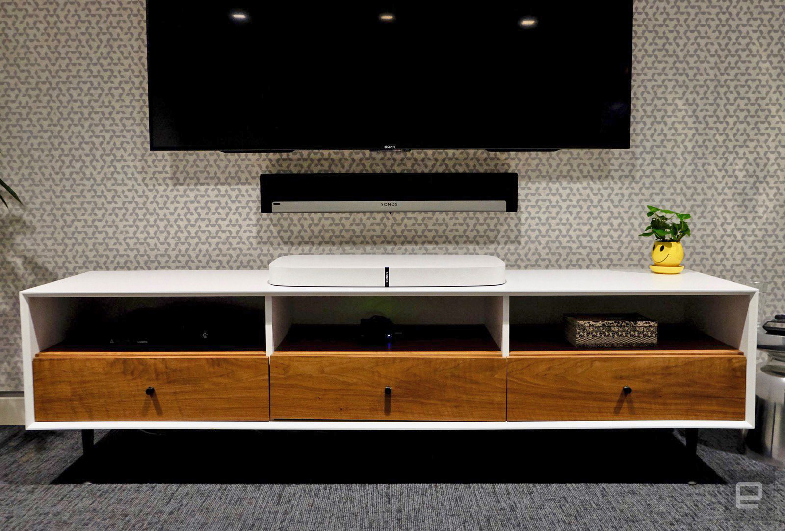 The Sonos Playbase, Pictured Here Below The Sonos Playbar Mounted To The  Wall.