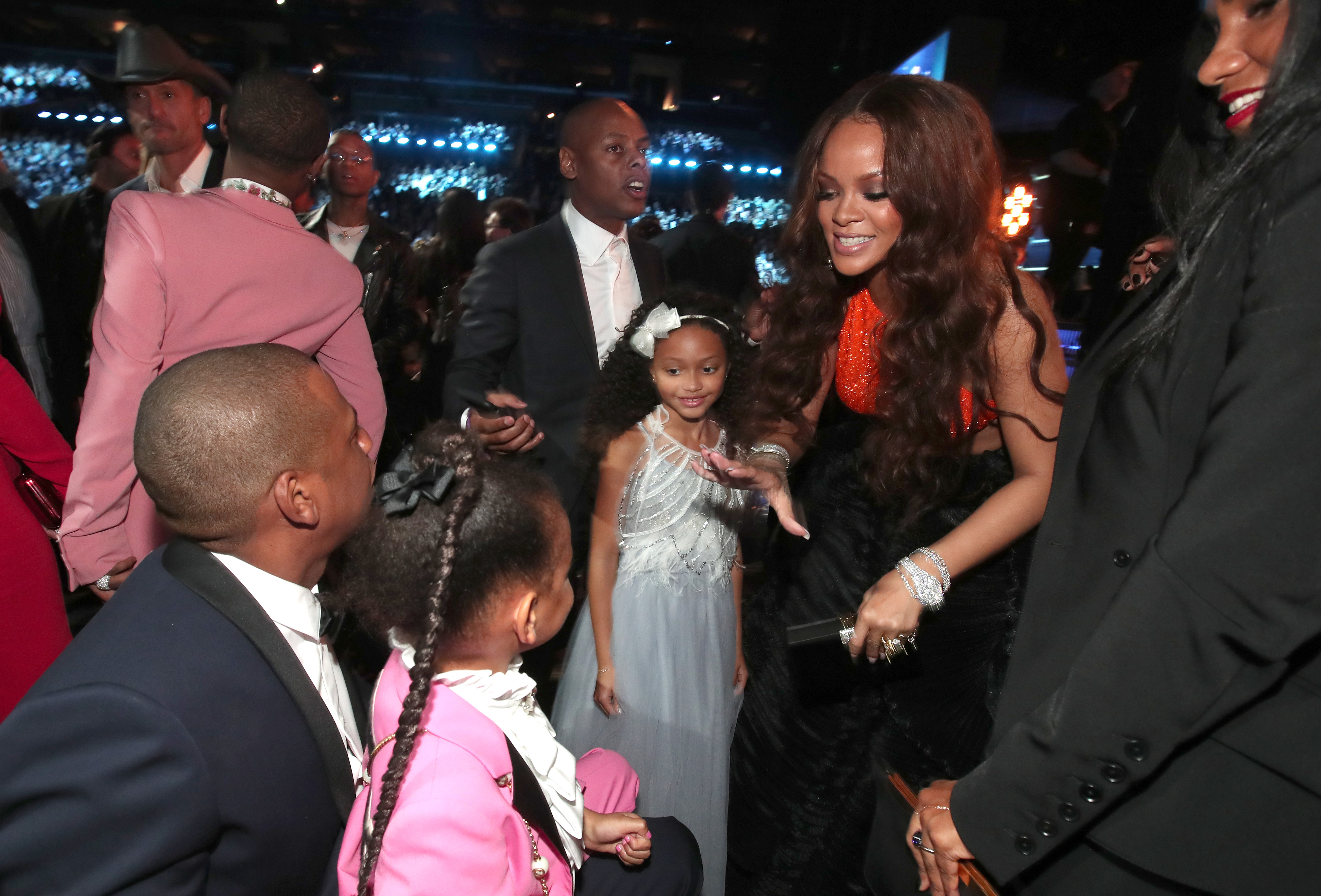 LOS ANGELES, CA - FEBRUARY 12:  Hip-Hop Artist Jay-Z, daughter Blue Ivy Carter and singer Rihanna during The 59th GRAMMY Awards at STAPLES Center on February 12, 2017 in Los Angeles, California.  (Photo by Christopher Polk/Getty Images for NARAS)