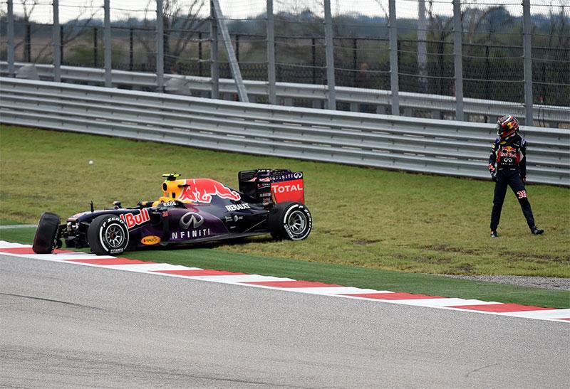 Daniil Kvyat walks away from his crashed Red Bull at the 2015 US Grand Prix.