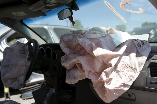 Deployed Takata manufactured airbags are seen on the driver and passenger sides of a 2007 Dodge Charger vehicle at a recycled auto parts lot in Detroit, Michigan May 20, 2015. Japanese air bag manufacturer Takata Corp is doubling a recall of potentially deadly air bags to nearly 34 million vehicles, making it the largest automotive recall in American history, U.S. safety regulators said on Tuesday. REUTERS/Rebecca Cook