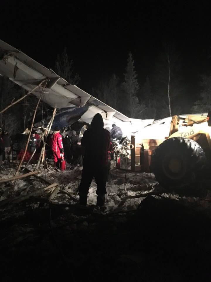 First responders work the crash scene near the Fond du Lac airport in a Wednesday, Dec. 13, 2017, image...