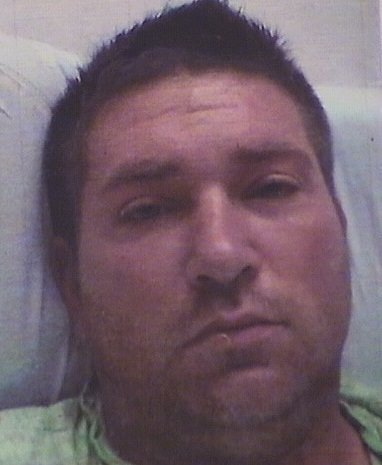 Reese M. Hartstirn, 33, is seen in a photo provided by the Cook County Sheriff's Office.