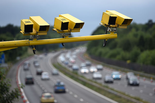 General view of three SPECS Average Speed cameras in position on the M3 motorway in Hampshire