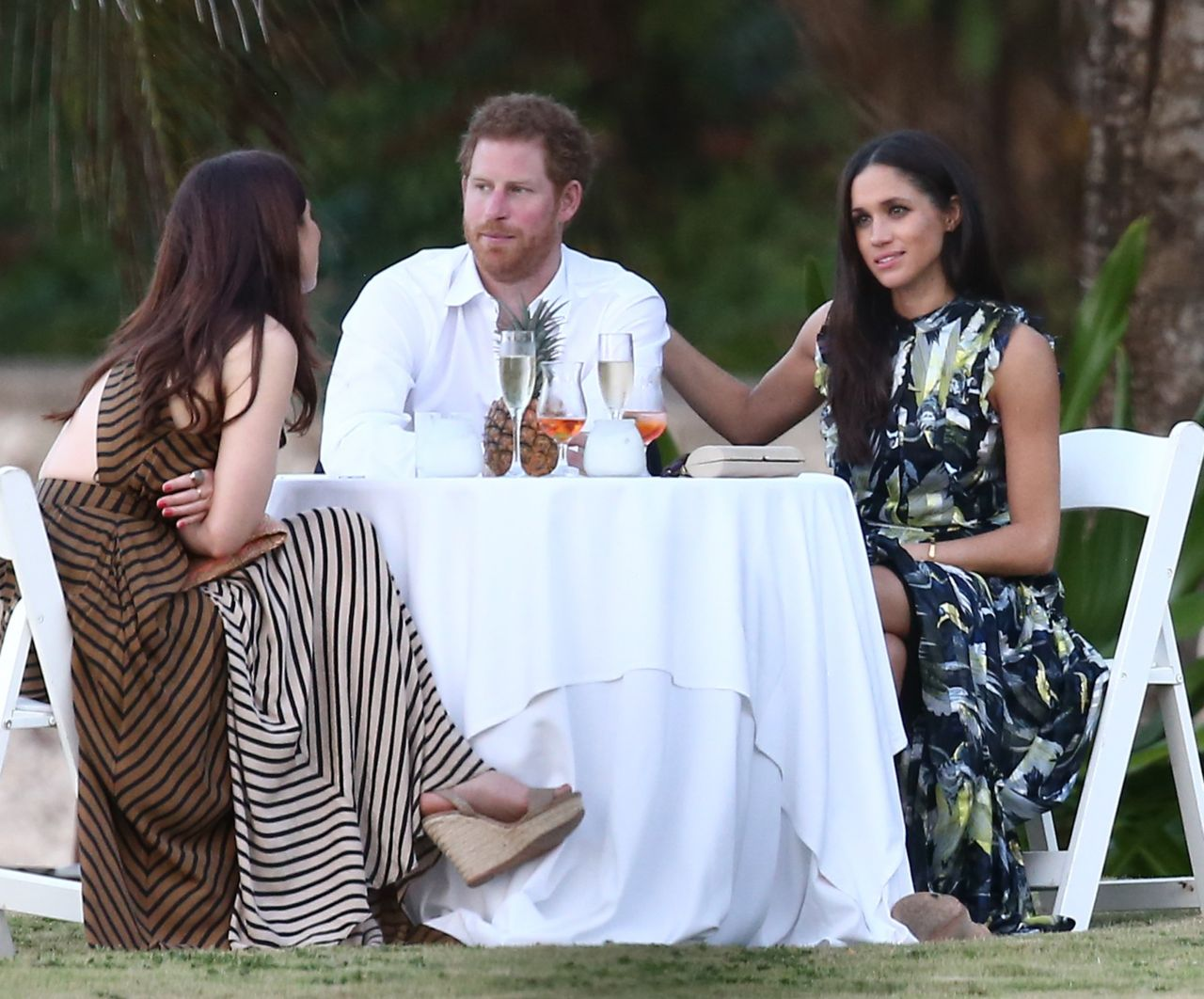 52334402 Royal couple Prince Harry and his girlfriend Meghan Markle were spotted attending a friend's wedding in Jamaica on March 3, 2017. Harry and Meghan enjoyed the festivities with the whole group before breaking off for some private conversation at a small table. Royal couple Prince Harry and his girlfriend Meghan Markle were spotted attending a friend's wedding near Jamaica on March 3, 2017. Harry and Meghan enjoyed the festivities with the whole group before breaking off for some private conversation at a small table. FameFlynet, Inc - Beverly Hills, CA, USA - +1 (310) 505-9876