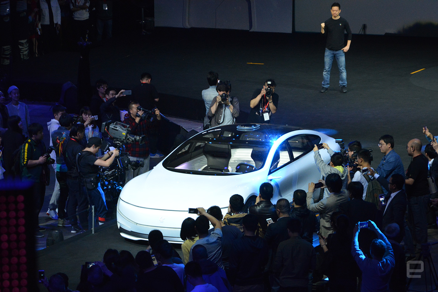 LeEco CEO Jia Yueting watches from afar while the LeSEE electric car drives itself on the stage.