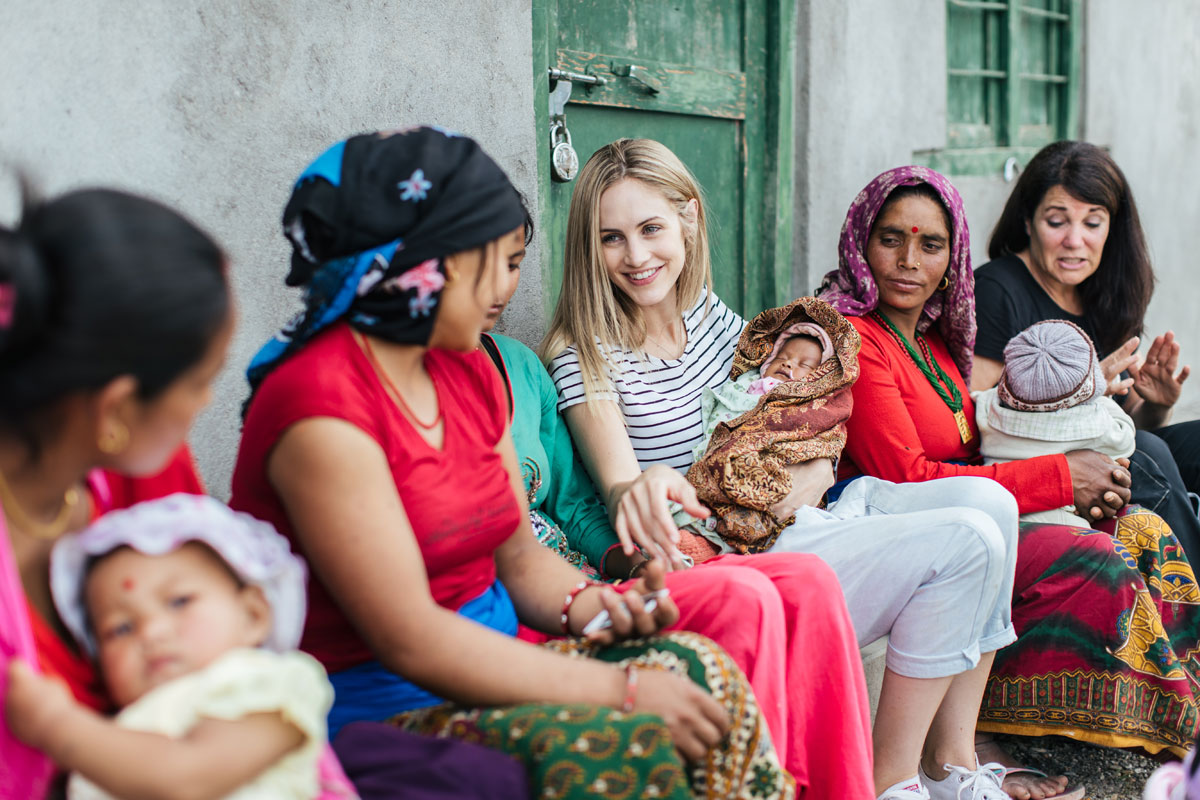 Co-founder Justine Flynn chats to local mothers in Nepal ahead of the brand's latest