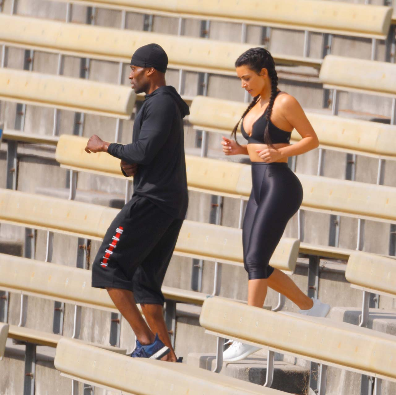 She was seen doing pull-ups and squats as well as running up and down some steps at near-by bleachers. Kim was working out for more than an hour and a half in the Lon Angeles heat before heading back to her car with her bodyguard. PICTURES BY SPLASH NEWS
