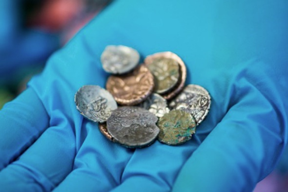 A precious hoard of Roman and Late Iron Age coins has been discovered in a British cave where they have lain undisturbed for more than 2,000 years
