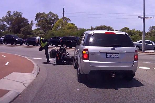 Motorists drives into police biker