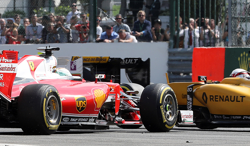 Ferrari's Sebastian Vettel of Germany crashes at the start of the Belgian F1 Grand Prix.