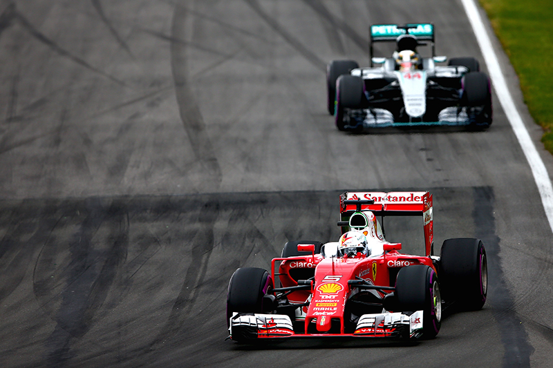 Sebastian Vettel of Germany driving the (5) Scuderia Ferrari SF16-H Ferrari 059/5 turbo (Shell GP) leads Lewis Hamilton of Great Britain driving the (44) Mercedes AMG Petronas F1 Team Mercedes F1 WO7 Mercedes PU106C Hybrid turbo on track during the Canadian Formula One Grand Prix at Circuit Gilles Villeneuve on June 12, 2016 in Montreal, Canada.