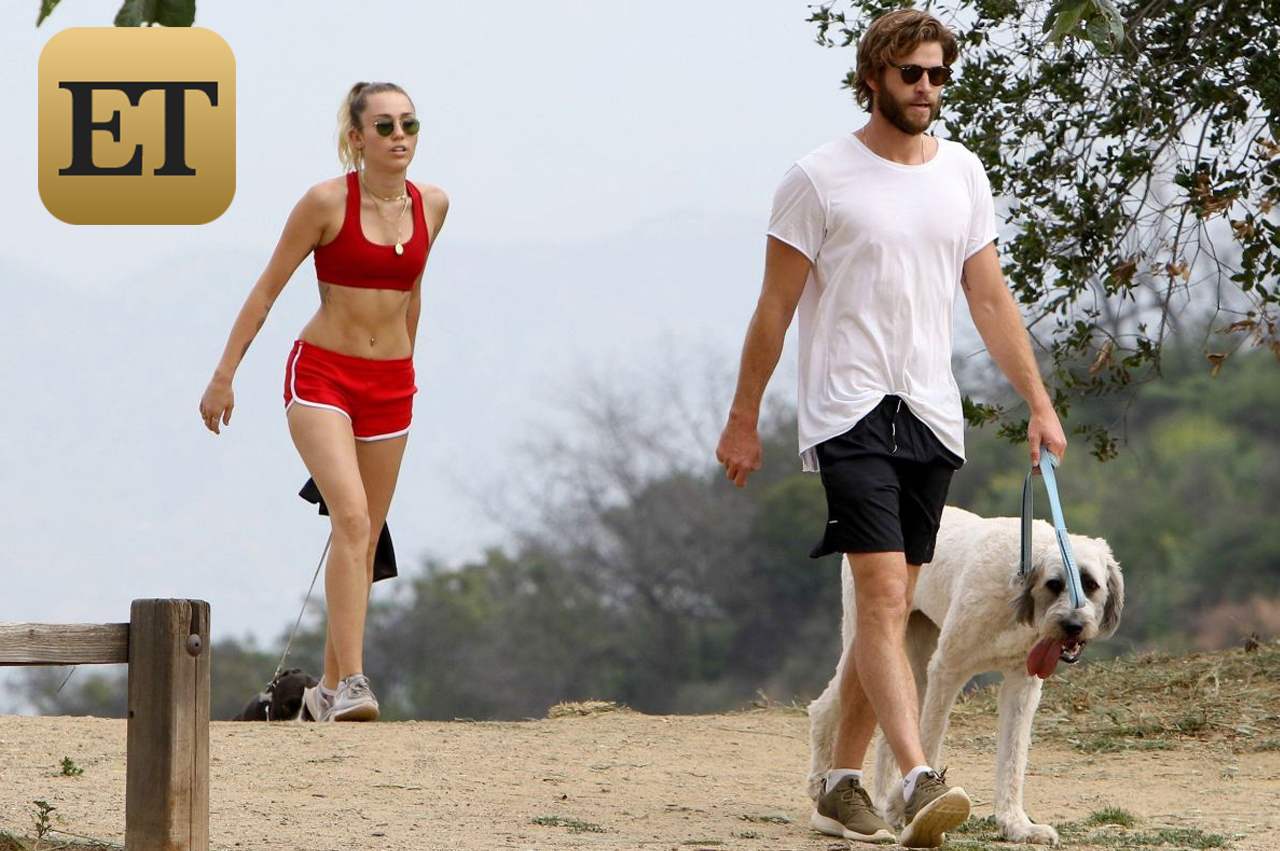 AG_808811 -  - *EXCLUSIVE* Los Angeles, CA - Miley Cyrus and Liam Hemsworth keep their bodies in shape by taking their dogs for a hike. Miley looked very fit and healthy showing off her abs in a red sports bra and matching red short shorts. Liam opted for a casual look with a plain white tee and navy board shorts. The couple shielded their eyes with sunglasses and looked to be finishing their hike as they were seen getting into their Range Rover to leave.  Pictured: Miley Cyrus, Liam Hemsworth  AKM-GSI 6 APRIL 2017  BYLINE MUST READ: LESE / AKM-GSI    Maria Buda (917) 242-1505 mbuda@akmgsi.com   Mark Satter (317) 691-9592 msatter@akmgsi.com or sales@akmgsi.com