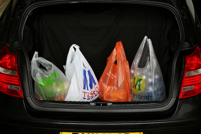 General view of Shopping bags from the four major supermarkets Asda, Tesco, Sainsbury's and Morrisons, in a car boot in Cambridge. PRESS ASSOCIATION Photo. Picture date:Wednesday October 2, 2013. See PA story. Photo credit should read: Chris Radburn/PA Wire