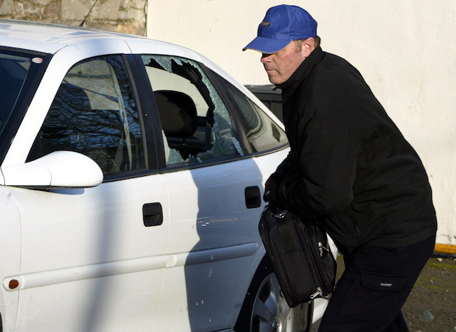 A thief breaks into a car during a mock-up by the Police Service of Northern Ireland in Belfast, Monday November 21, 2005. More than £1.6 million worth of property has been stolen from vehicles in Northern Ireland over the last year, police revealed today. Half of all thefts happened in residential areas, with around a quarter each in car parks and at the roadside. Audio equipment was the most regularly seized, followed by tools, car parts and handbags. See PA Story ULSTER Vehicle. PRESS ASSOCIATION Photo. Photo credit should read: Paul Faith/PA