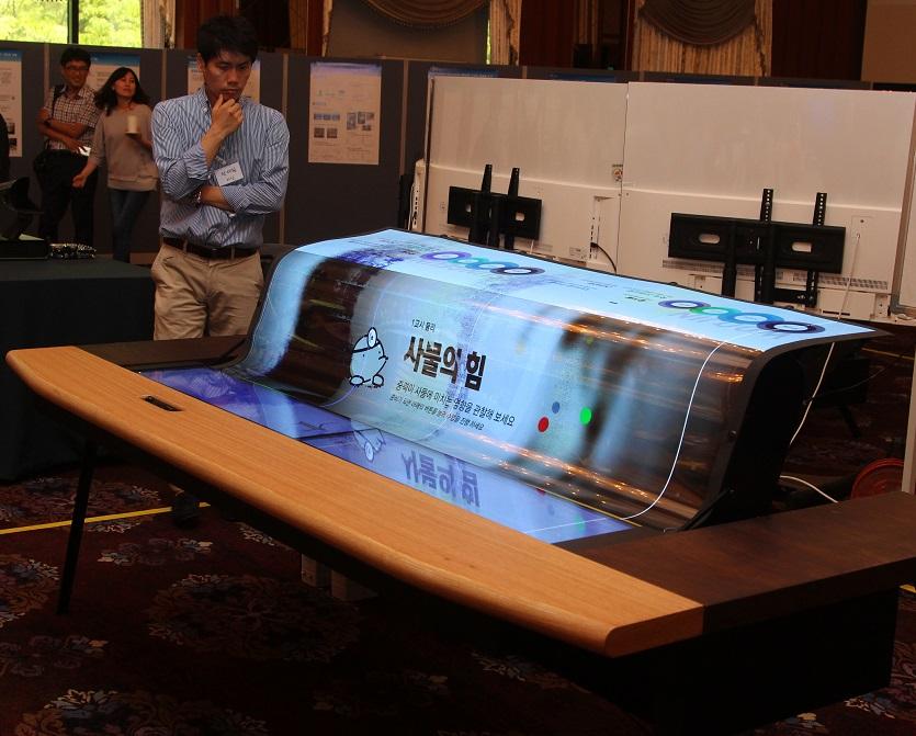 lg 39 s latest oled display is flexible transparent and gargantuan. Black Bedroom Furniture Sets. Home Design Ideas