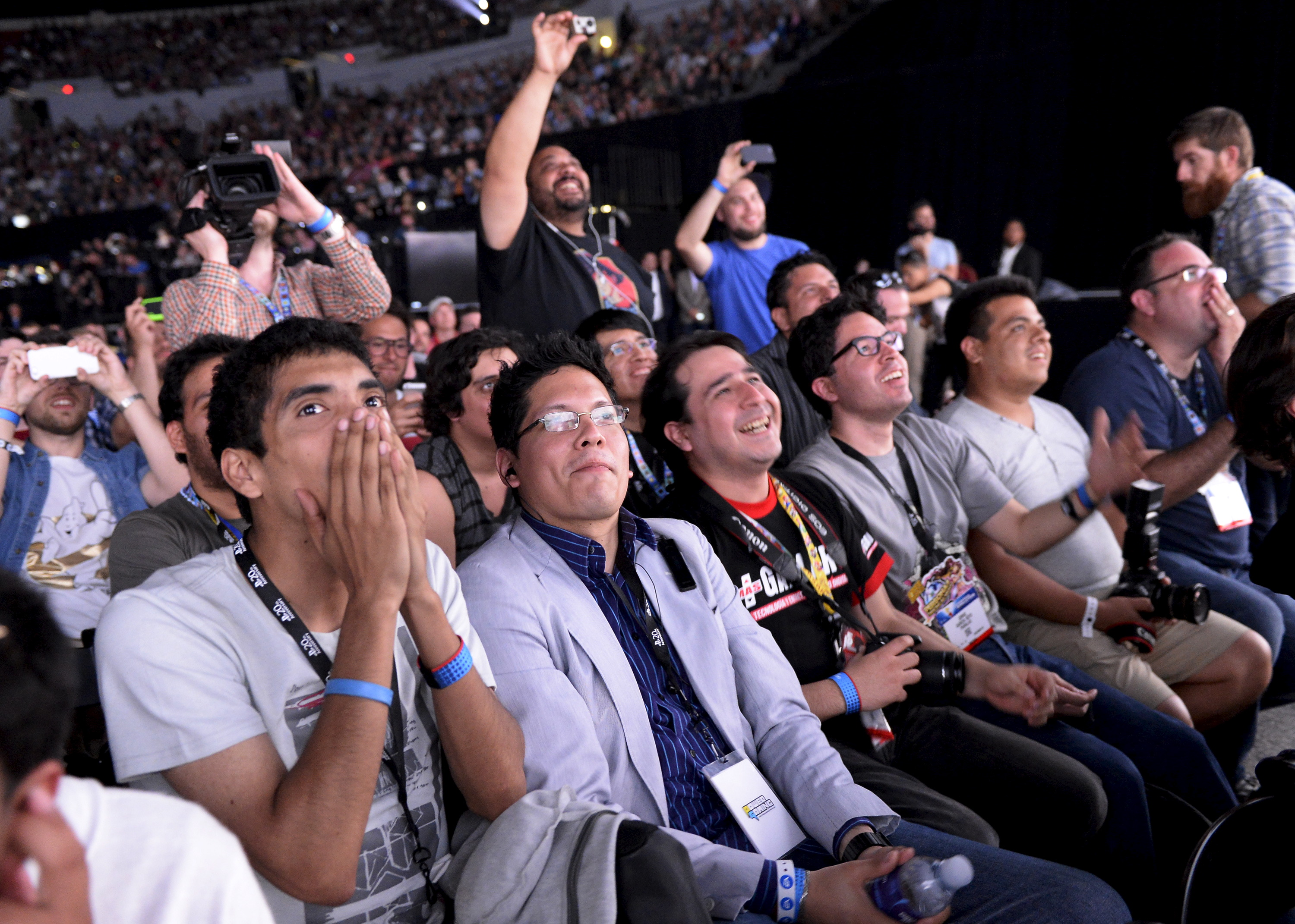 Attendees react during a video game presentation at the Sony Playstation E3 conference in Los Angeles, California June 15, 2015. REUTERS/Kevork Djansezian