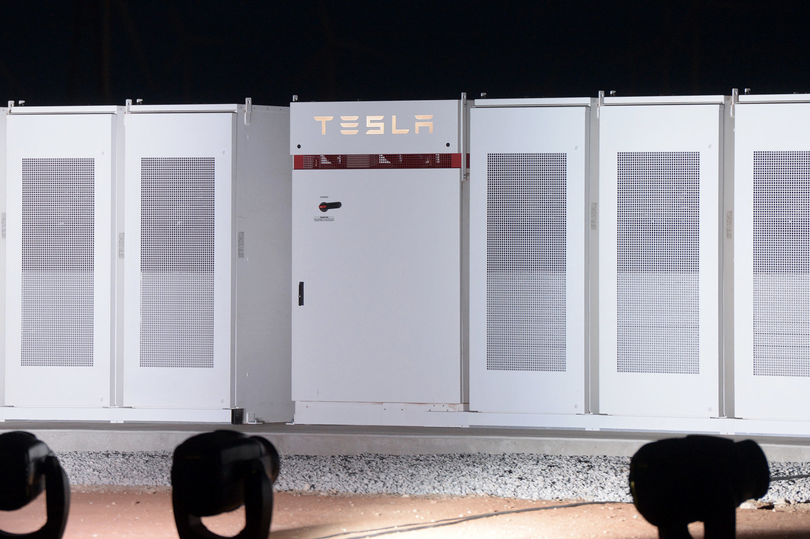 TeslaInc. Powerpacks that will be used to form theworld's largestlithium-ionbattery stand on display at the Hornsdale wind farm, operated by Neoen SAS, near Jamestown, South Australia, on Friday, Sept. 29, 2017. Tesla Chief Executive Officer Elon Musk descended on South Australia on Friday to unveil progress on a giant battery seen critical to averting crippling powershortages in the state. Photographer: Carla Gottgens/Bloomberg via Getty Images