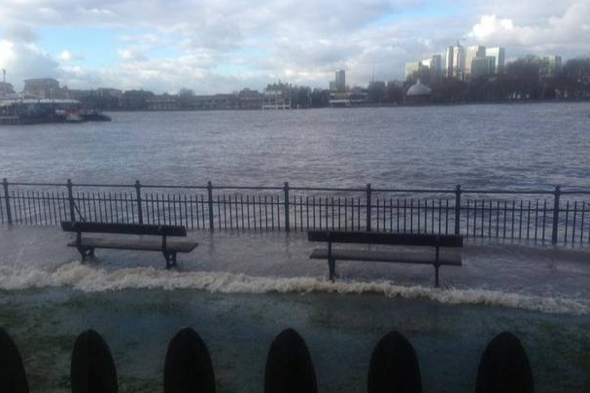 River Thames bursts banks high spring tide