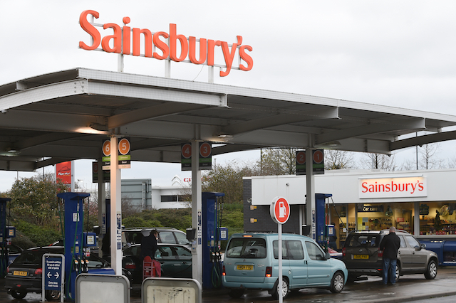 "Sainsbury's in Coventry where petrol has dropped to under a £1. Sainsbury's along with Tesco, Asda and Morrisons have cut the cost of petrol to under £1 a litre, raising the stakes in the Christmas price war. PRESS ASSOCIATION Photo. The Asda price drop, falling by 2p to 99.7p, will last three days from Friday, while Morrisons said it hopes to keep its everyday price of 99.9p for ""as long as possible"".  Picture date: Saturday December 12, 2015. See PA story TRANSPORT Fuel. Photo credit should read: Joe Giddens/PA Wire"