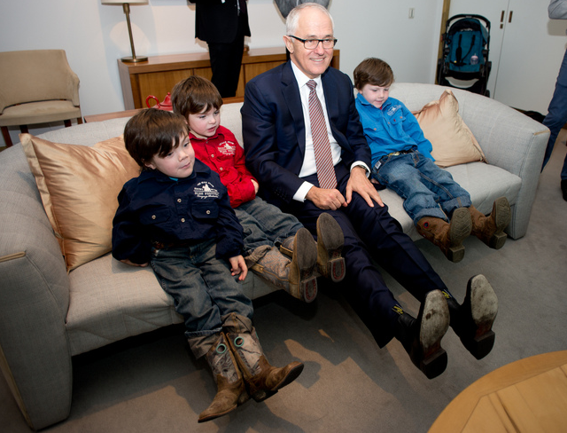 Beau Cosgrove (far left) with his brothers, comparing 'cowboy boots' with Prime Minister Malcolm