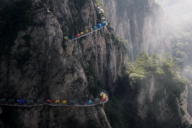Tourists set up camp on 1,700m high cliff edge