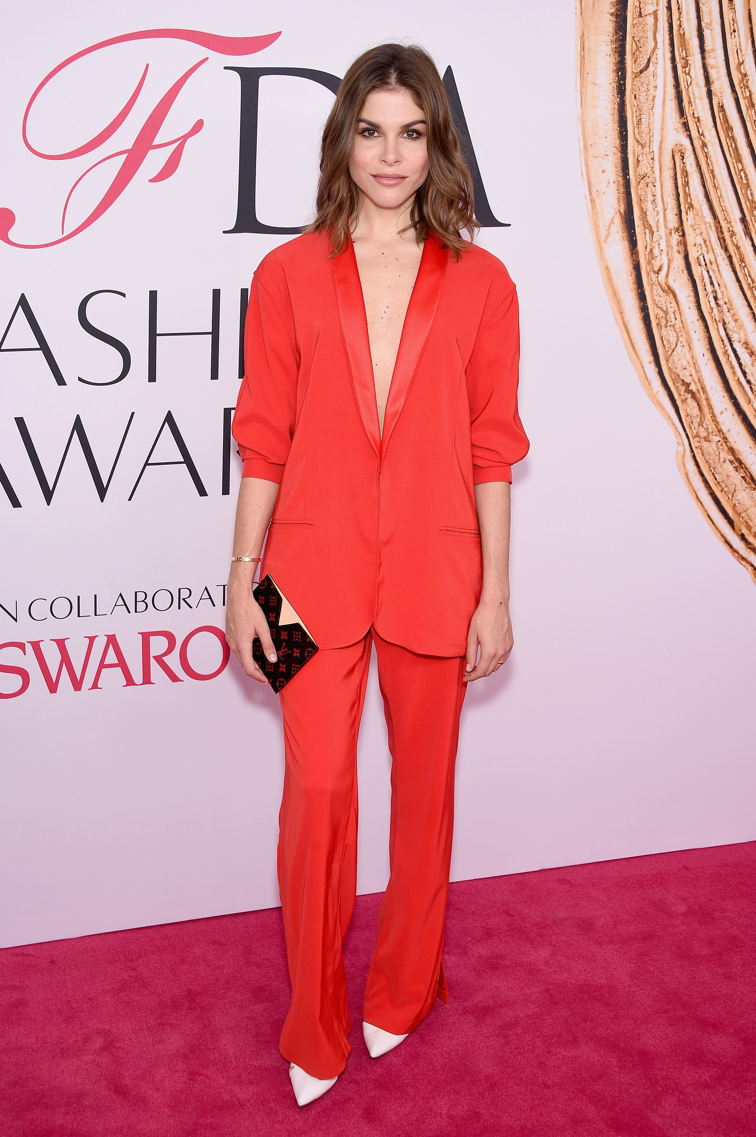 Emily Weiss attends the 2016 CFDA Fashion Awards in plunging red