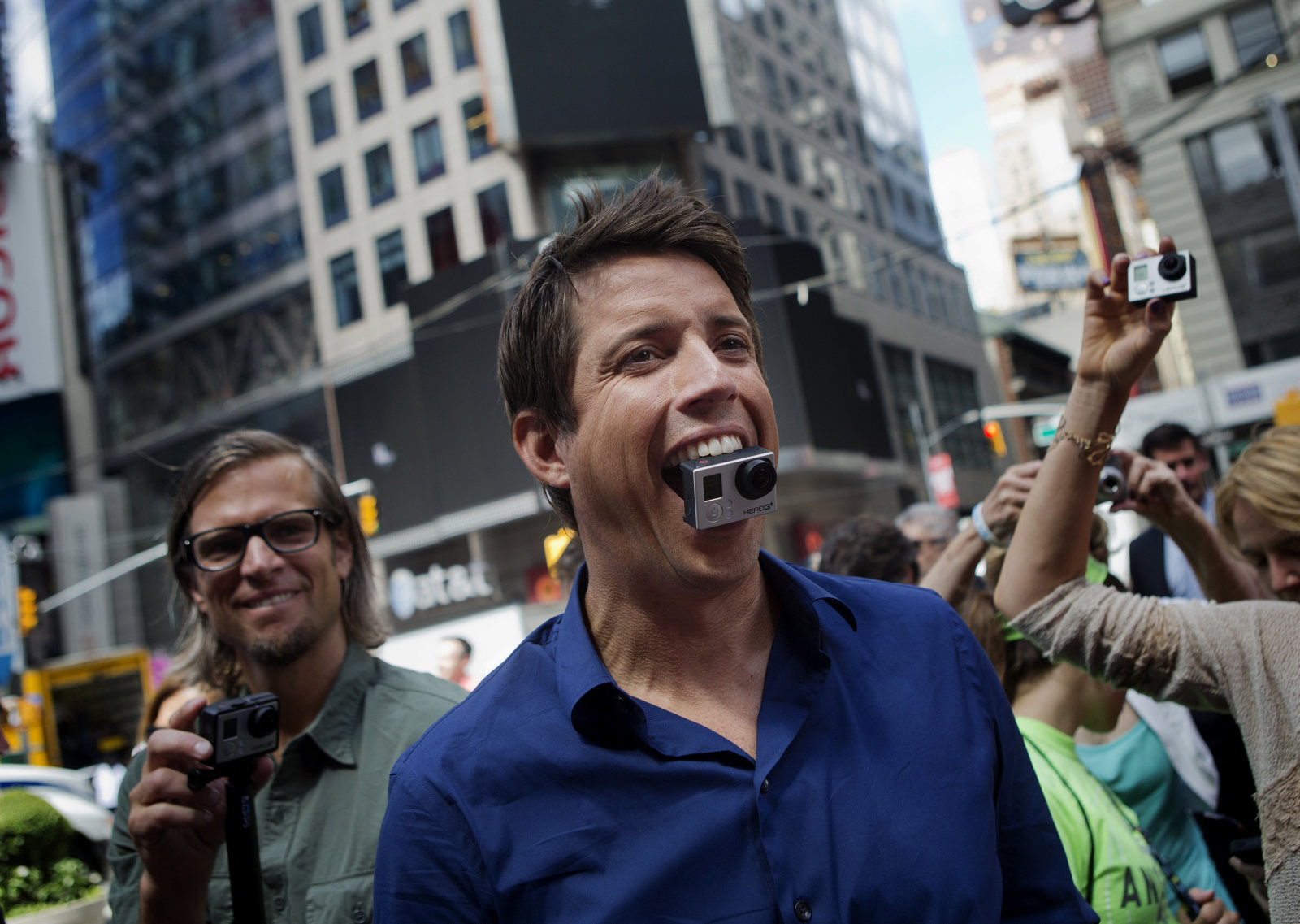 Bloomberg's Best Photos 2014: Nick Woodman, founder and chief executive officer of GoPro Inc., stands for a photograph with a GoPro Hero 3+ camera in his mouth after ringing the opening bell for the release of the company's IPO at the Nasdaq MarketSite in New York, U.S., on Thursday, June 26, 2014. GoPro Inc., whose cameras let surfers, skiers and sky divers record their exploits, rose in its trading debut after pricing its initial public offering at the top of the marketed range. Photographer: Victor J. Blue/Bloomberg via Getty Images