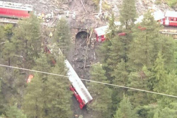 Train derails in Swiss Alps: Carriages hanging over ravine