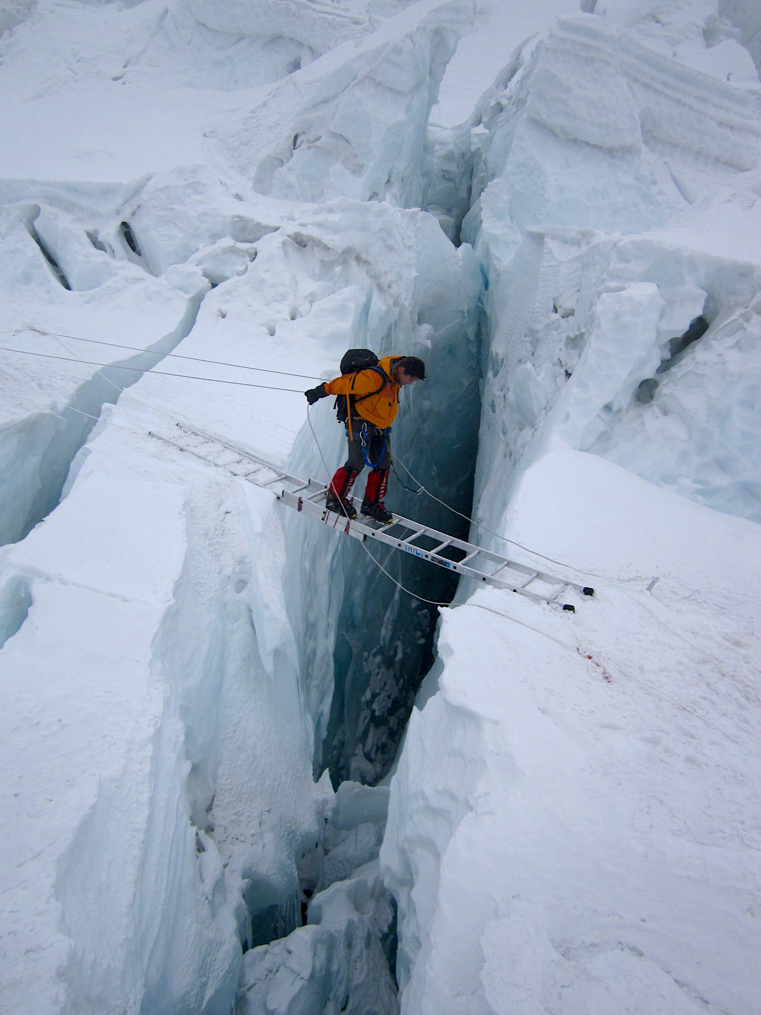The author on a ladder in the Khumbu