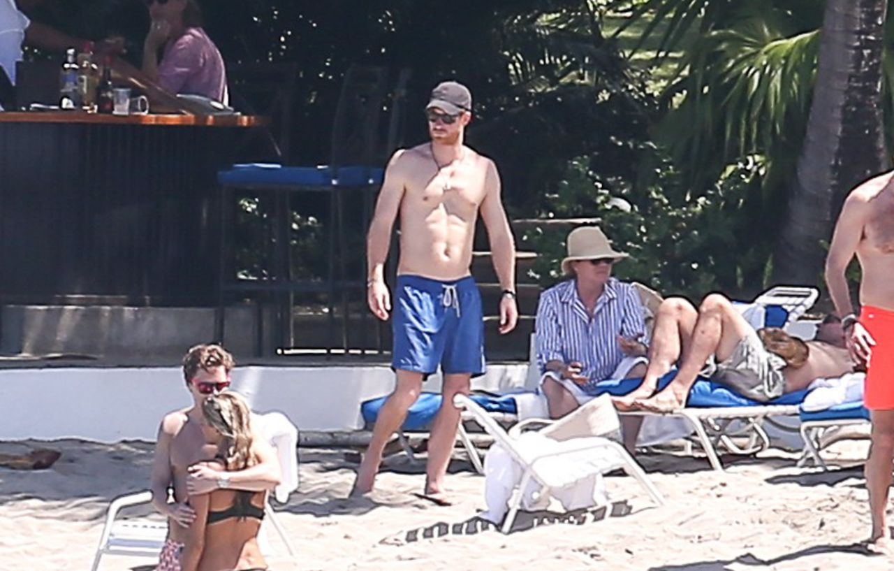 52334918 Prince Harry was spotted at a beach in Jamaica on March 4, 2017 with friends. Harry and Meghan are on vacation attending a friends wedding. FameFlynet, Inc - Beverly Hills, CA, USA - +1 (310) 505-9876