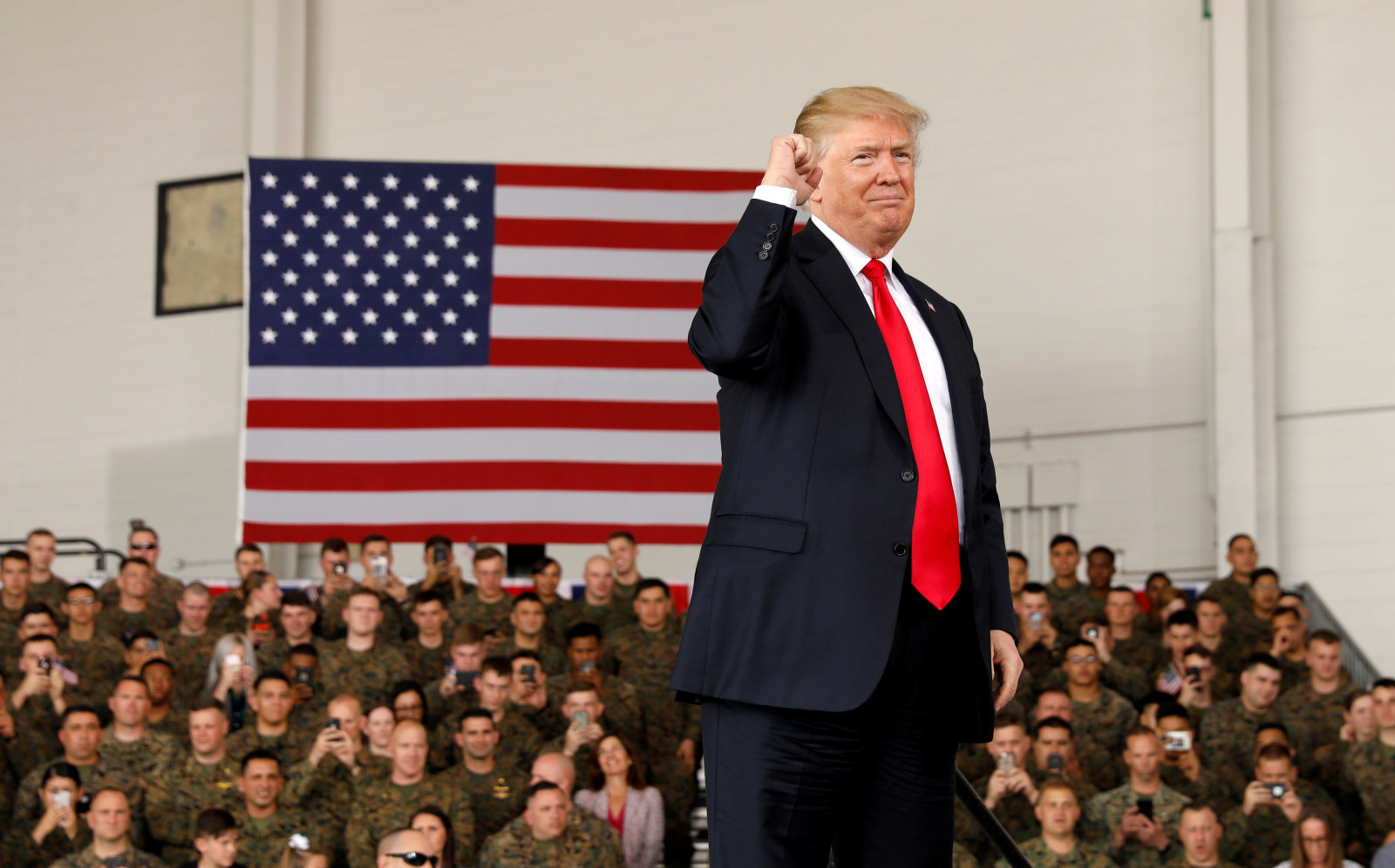U.S. President Donald Trump pumps his fist after speaking at Marine Corps Air Station Miramar in San Diego, California, U.S. March 13, 2018. REUTERS/Kevin Lamarque     TPX IMAGES OF THE DAY
