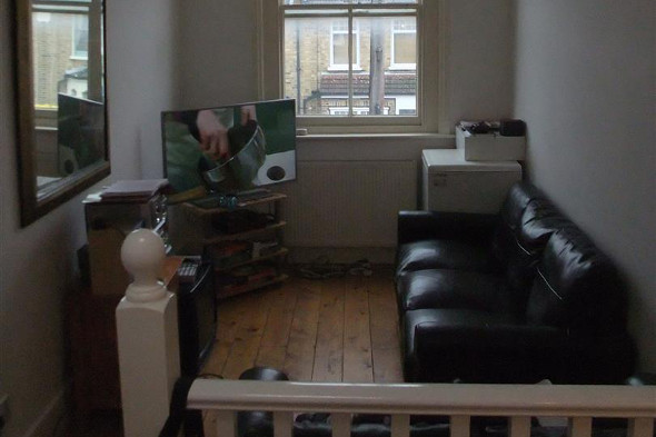 The living room of the narrow Hackney house