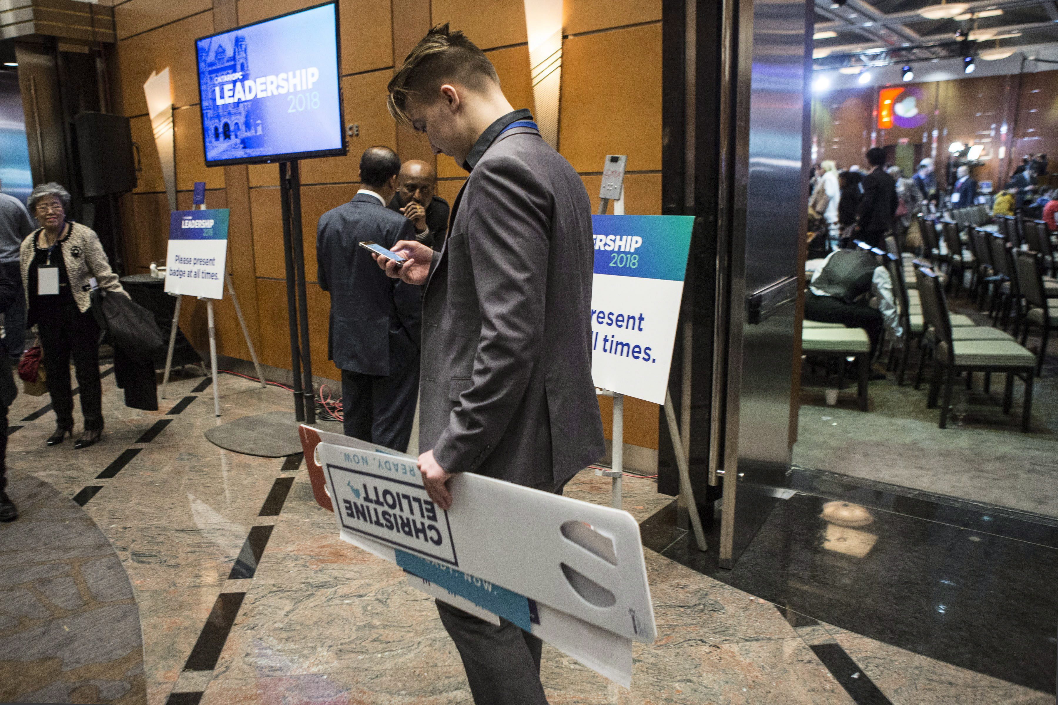 A Christine Elliott supporter leaves the convention