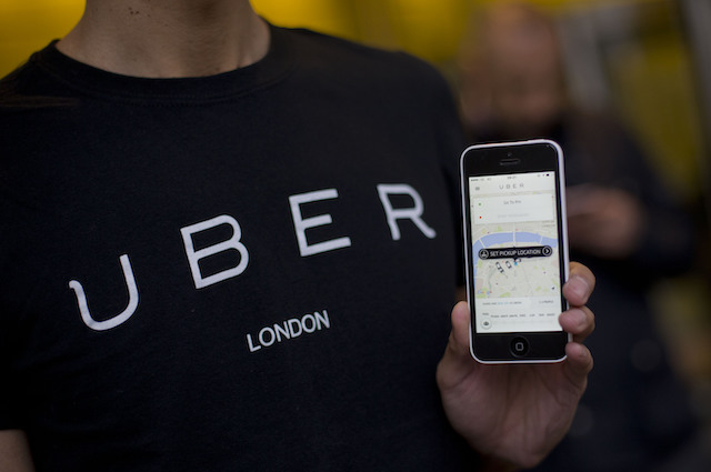 A Uber driver with an app on his phone, as they handed over a petition signed by over 205,000 people to Transport for London - ahead of a consultation by TfL on private hire in the capital - at 197 Blackfriars Road in London. PRESS ASSOCIATION Photo. Picture date: Tuesday December 22, 2015. Photo credit should read: Yui Mok/PA Wire