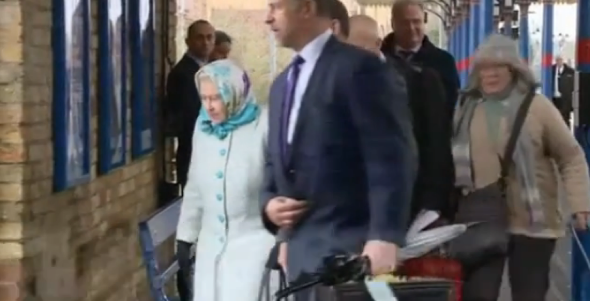 Oblivious train passenger nearly bumps into the Queen