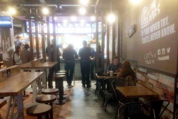 The policemen inside the restaurant.