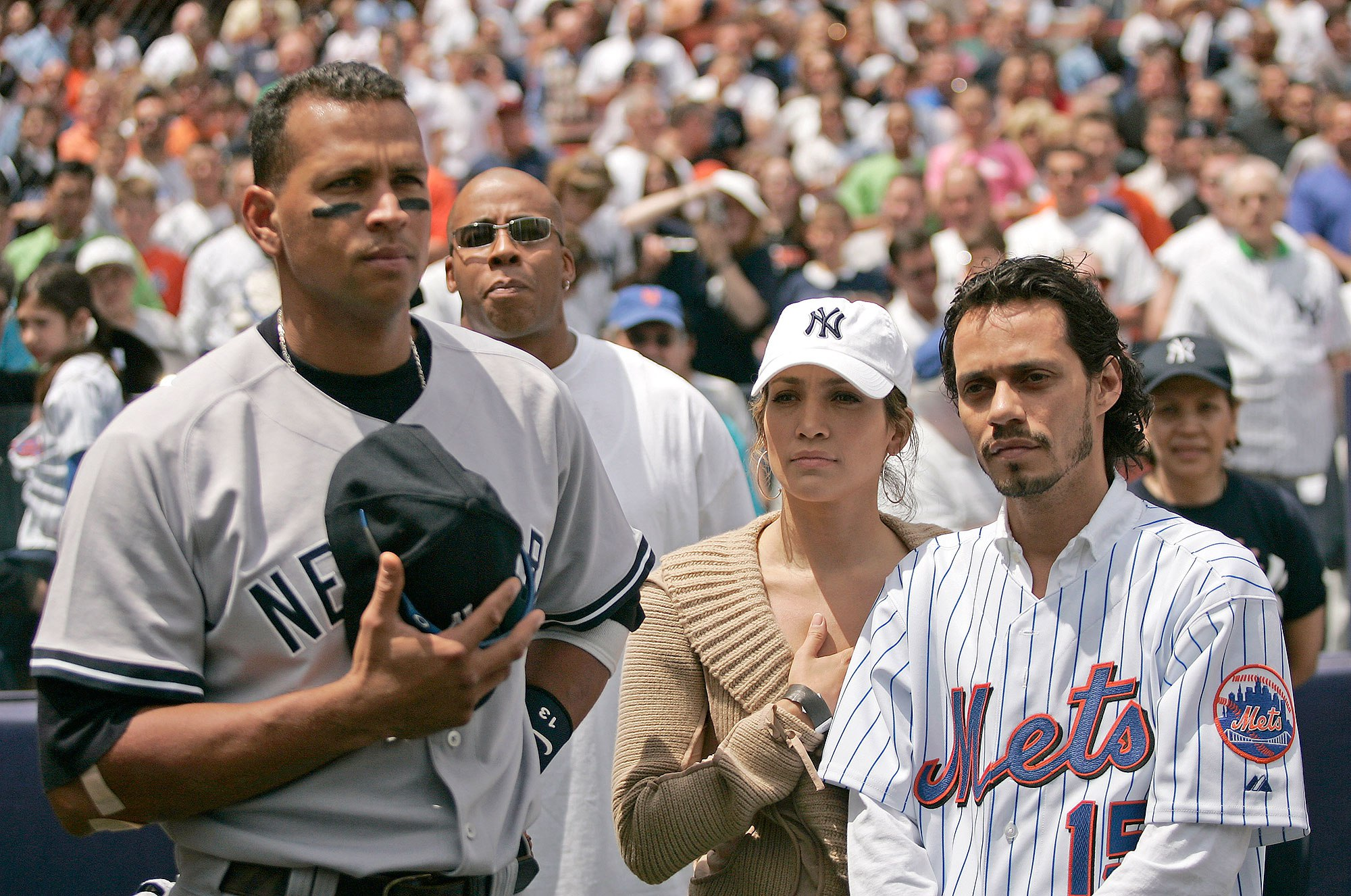 Actress Jennifer Lopez and husband Marc Anthony with New York Yankee Alex Rodriguez before a subway series game between the New York Mets and the New York Yankees at Shea Stadium in Queens, New York on Saturday May 21, 2005. The Mets beat the Yankees 7-1. (Photo by Mike Ehrmann/WireImage)