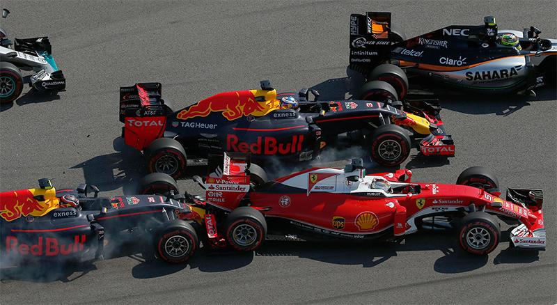 Ferrari driver Sebastian Vettel of Germany, right, is pushed by Russiaâs Red Bull driver Daniil Kvyat, left.